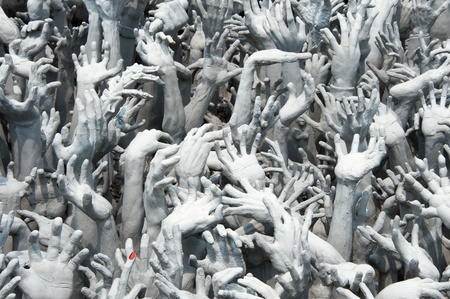 The sculpture represent the hands of evils at White Buddhist temple in Northern Thailand photo