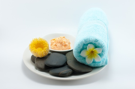 Set of body scrub and stone for body massage photo