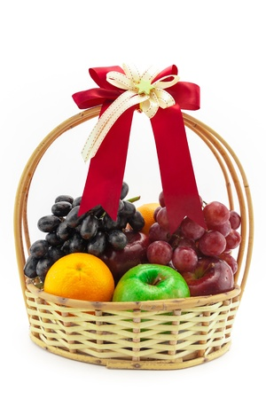 gift basket: Many kind of fruits in the gift basket Stock Photo