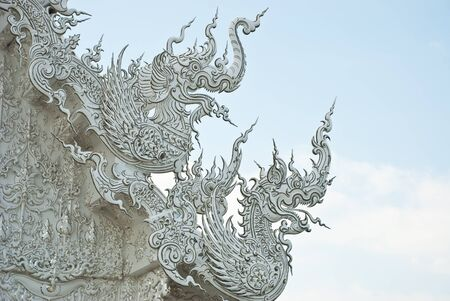 Art on the roof of Wat Rong Khun. Stock Photo