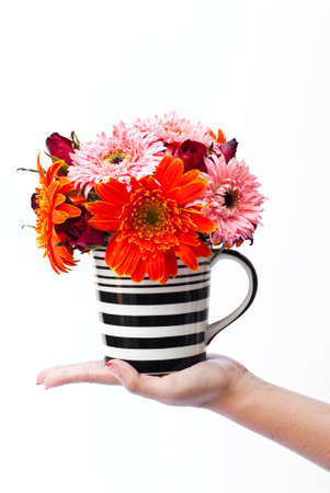 Vase of the many colorful flowers combined together.