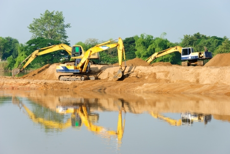 Excavation with a backhoe. Stock Photo