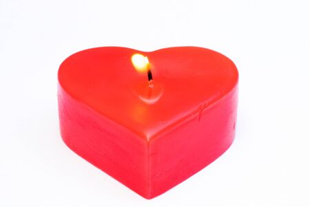 Heart shaped candles. On a white background.