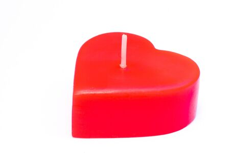 Candle of love on a white background. Stock Photo