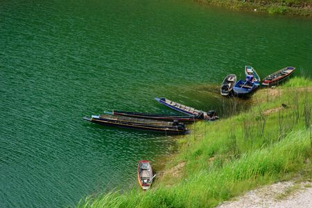 Traditional fishing boat on the lake. Stock Photo
