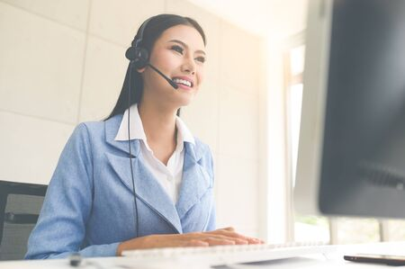Call Center Service. Photo of customer support or sales agent.  Help line answering and telemarketing. Female caller or receptionist phone operator.Copy space for some text, advertising or slogan.