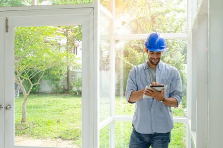Engineers calculated the construction budget.The young engineer review the construction. Old House Renovation. Architect checking design details. Stockfoto