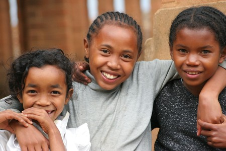 nomads: November 2005 - Madagascar children posing and smiling to the camera, Taken from rural village near Antananarivo city
