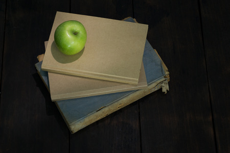 green life: still life green apple and old books