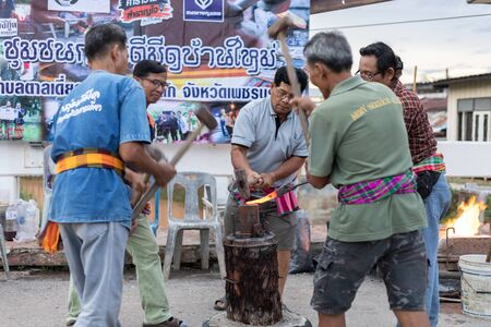 Petchaboon Province, Thailand - 30 June, 2018 - Metalworkers show hit hot iron for knife on walking street saturday evening is old culture in north Thailand