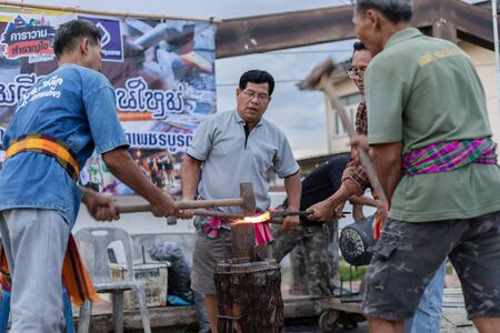 Phetchabun Province, Thailand - 30 June, 2018 - Metalworkers show hit hot iron for knife on walking street saturday evening is old culture in north Thailand