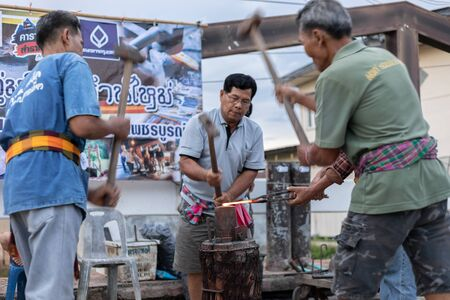 Petchaboon Province, Thailand-30 June, 2018 - Metalworkers show hit hot iron for knife on walking street saturday evening is old culture in north Thailand