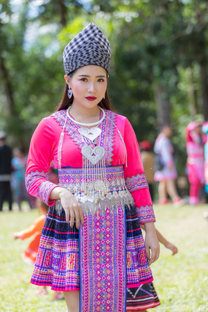 Hmong girl in beautiful dress colorful and fashion mixed between new and old culture ,is handmade for Hmong new year festival in north Thailand