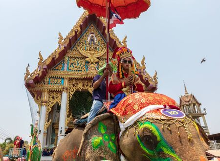 Sri Satchanalai Province,Thailand-April 7,2019 ,Many people celebrate in Thai old culture on Hudson village, Man go into the monkshood on the elephant cross the river more than a 100th year old