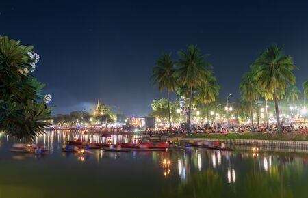 Many peoples in Loykratong and candle festival day for look shows light and sounds at sukhothai province in Thailand 版權商用圖片