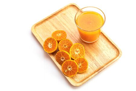 Fresh orange and pure orange juice in glass and bottle for good healthy, on wooden place