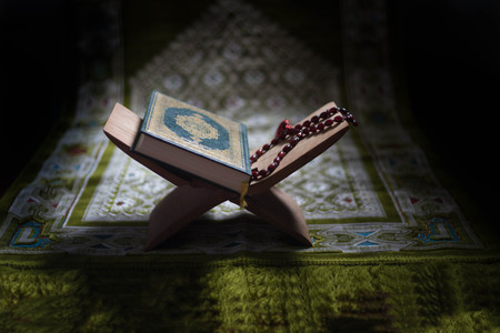 Quran - holy book of Muslims around the world put on wooden boards