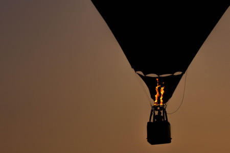 Shadow of a balloon floating in the air.