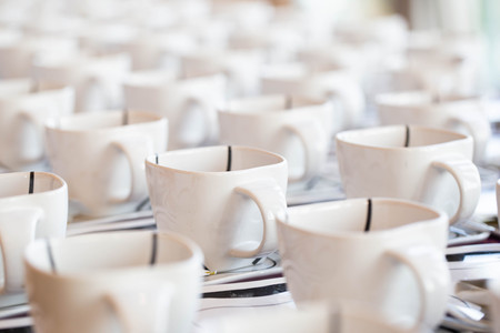 Many coffee cups, customer service during the conference break