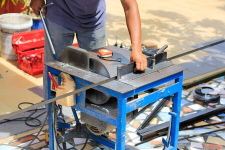 Workers are using aluminum slitting machines and aluminum slitting lines