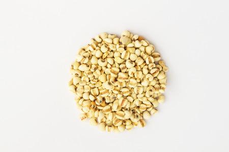Millet (grain) in isolate on white.