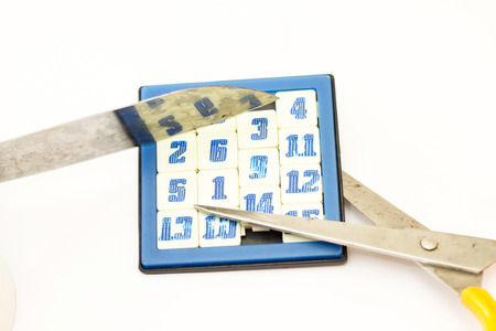 scissors and number switch game in isolate on white. Stock Photo