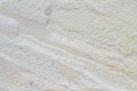 Patterned sandstone texture background (natural color). sandstone in Thailand. For wallpaper or used as a raw material in various designs Banco de Imagens
