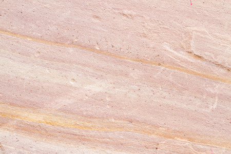 Patterned sandstone texture background (natural color). sandstone in Thailand. For wallpaper or used as a raw material in various designs photo