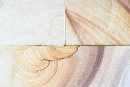 パターン化された砂岩テクスチャ背景 (自然色)。タイの砂岩。壁紙の様々 なデザインで原料として使用されるか。 写真素材