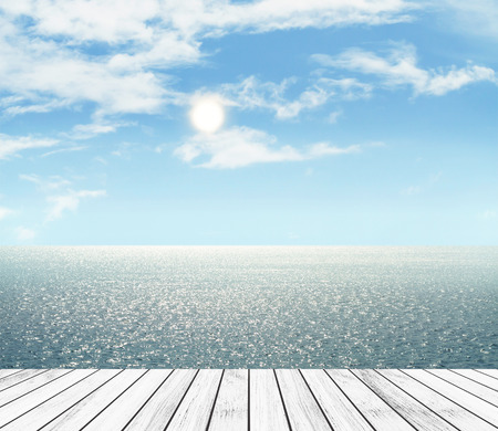 Sea and sky in the daytime and wood slabs arranged in perspective background for design. Stock Photo