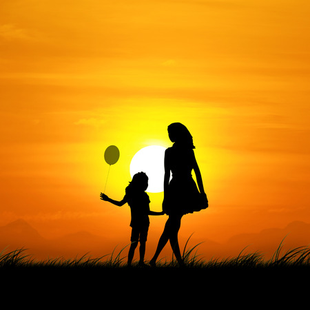 Silhouette of the girl and the mother in the beautiful sunset.