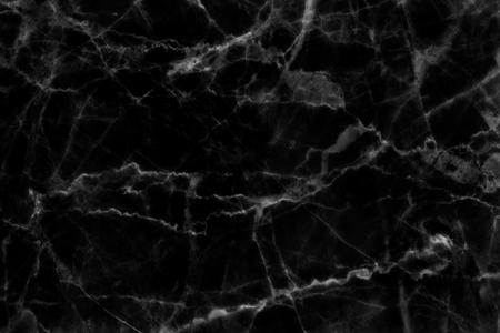 Priorità bassa di struttura modellata in marmo nero per il design.