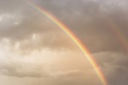 two bright rainbows in the sky after a thunderstorm, close-up