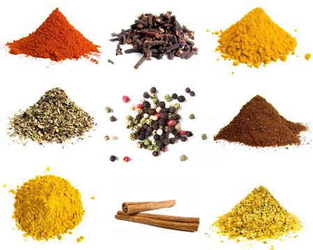 Variety of colorful grounds spices isolated on white photo