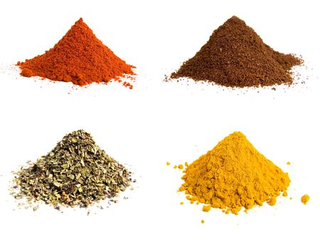 Variety of colorful grounds spices isolated on white Banque d'images
