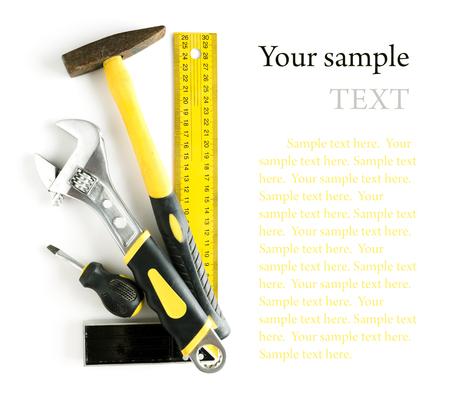 herramientas de construccion: Herramientas marco aislado en fondo blanco con copyspace y texto de ejemplo Foto de archivo