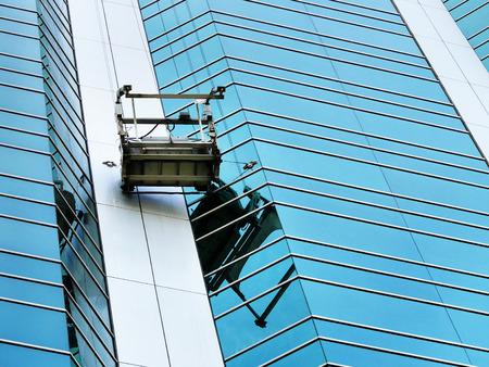 steeplejack: washing platform on windows in the office building