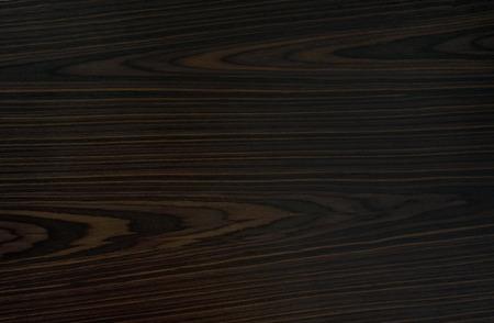 Ebony background - black, dark, expensive wood.