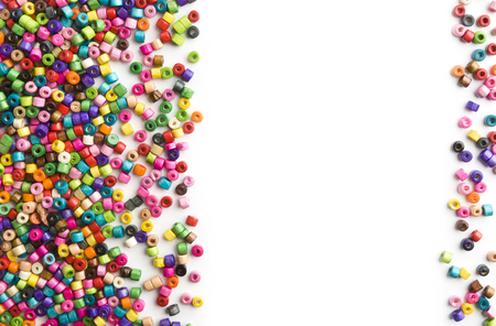 Colorful wooden beads frame on white background