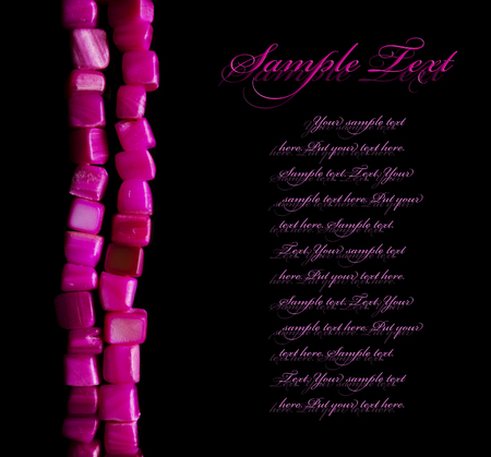 pink pearl: Pink pearl beads necklace on black background with copy space and sample text