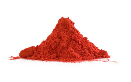 Pile of red powder isolated on white