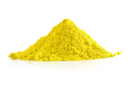 Pile of yellow powder isolated on white background Stock Photo