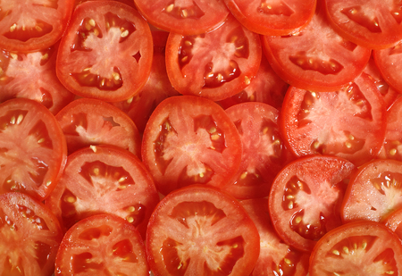 sliced: Tomato slices. Natural background with slices of tomato. Stock Photo