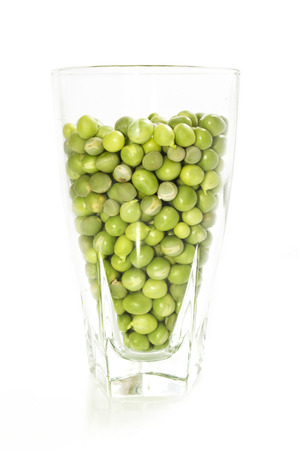 pea pod: Glass of green peas on a white background Stock Photo