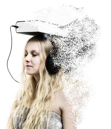 disintegration: Audio book idea - a young woman with headphones connected to the book - disintegration effect