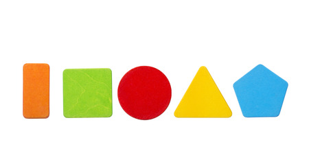 Colorful wooden toy blocks in geometric shapes. Orange rectangle, green square, red circle, yellow triangle and blue pentagon on white background. Imagens