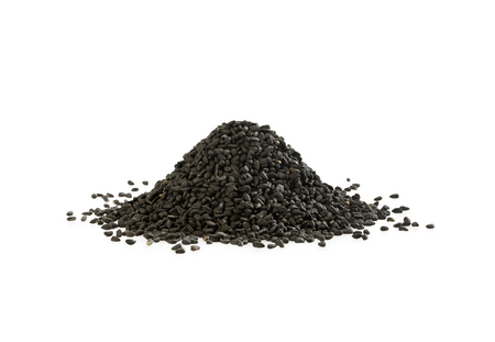 Black cumin heap on white background. A pile of nigella sativa seed.
