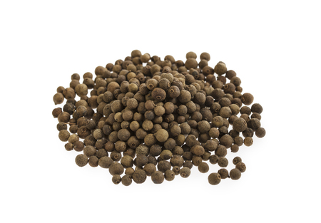 Allspice spice pile isolated on white background. Stacked.