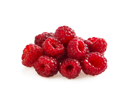 Heap of ripe raspberry isolated on white.
