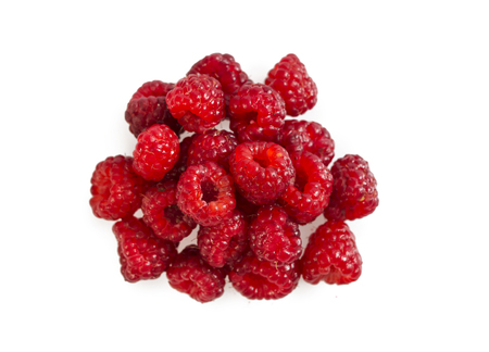 Heap of ripe raspberry isolated on white